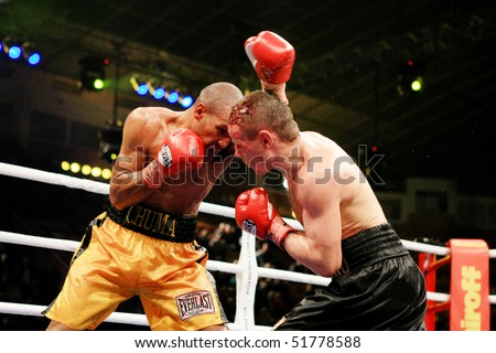 KIEV, UKRAINE - APRIL 19: WBA welterweight belt holder Yuriy Nuzhnenko(R) throws a punch against Irving Garcia during their WBA World Welterweight Title fight on April 19, 2008 in Kyiv, Ukraine