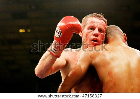 KIEV, UKRAINE - APRIL 19: WBA welterweight belt holder Yuriy Nuzhnenko throws a punch against Irving Garcia during their WBA World Welterweight Title fight on April 19, 2008 in Kyiv, Ukraine
