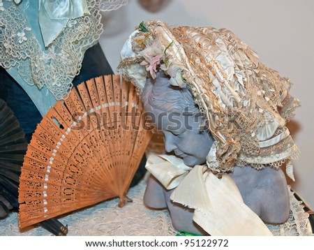 KIEV, UKRAINE - APRIL 16: Woman bust with fine bonnet and fan are on display at the museum exhibit of Marina Ivanova\'s private collection of antique woman\'s clothes on April 16, 2011 in Kiev, Ukraine