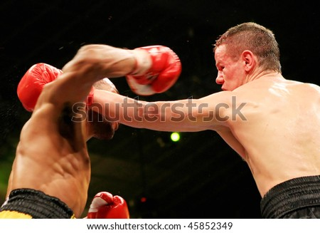 KIEV, UKRAINE - APRIL 19: Yuriy Nuzhnenko of Ukraine (R) throws a punch against Irving Garcia of Puerto Rico during their WBA World Welterweight Title fight on April 19, 2008 in Kiev, Ukraine