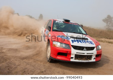 "KIEV, UKRAINE - AUGUST 15: Petrenko Y. and Eremenko D. drives their Mitsubishi EVO 9 at the 5-th stage of the championship of Ukraine ""Alexandrov Rally 2010"" on August 15, 2010 in Kiev, Ukraine."