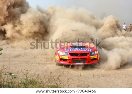 "KIEV, UKRAINE - AUGUST 15: Salyuk Alexander, Jr. driving his car Mitsubishi Evo 9 at the 5-th stage of the championship of Ukraine ""Alexandrov Rally 2010"" on August 15, 2010 in Kiev, Ukraine."
