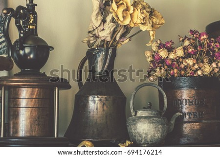 Kiev, Ukraine - August 2017: Vintage kitchenware, dry roses. Vintage kitchen interior, vintage objects and utensils, hone design with vintage elements, Kiev, Ukraine #694176214