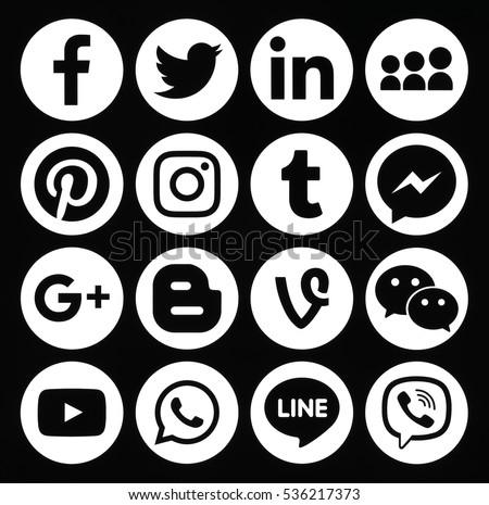 Kiev, Ukraine - December 05, 2016: Collection of popular round white social media icons printed on black paper: Facebook, Twitter, Google Plus, Instagram, Pinterest, LinkedIn, Tumblr and others
