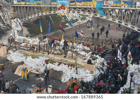 KIEV, UKRAINE - DECEMBER 14: Demonstrators guard EuroMaidan barricades on Institutska street during peaceful protests against Ukrainian president and government on December 14, 2013 in Kiev, Ukraine.
