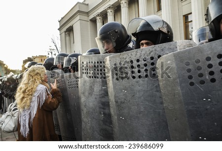 KIEV, UKRAINE - December 23, 2014: Woman talking with the National Guard. -- To break through the cordon of police and four special forces in full uniform