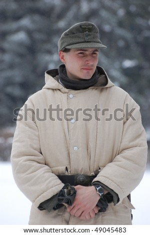 KIEV, UKRAINE - FEB 13: Member of a history club RED STAR wears historical German uniforms during a WWII reenactment of 'Defense Kiev in 1943' on February 13, 2010 in Kiev, Ukraine