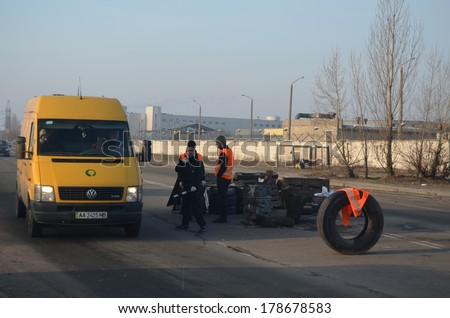 KIEV, UKRAINE - FEB 24, 2014: Traffic regulation point,created people Self defense of Kiev.Troeshina district