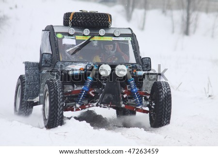 KIEV, UKRAINE - FEBRUARY 13: Quad bike's drivers Andriy Guta and Anton Fink (Baggi) ride over snow track during Baja Kyiv-2010 Rally on February 13, 2010 in Kiev
