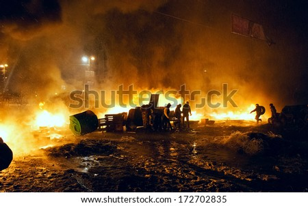 KIEV, UKRAINE - 22 JANUARY 2014: Unknown demonstrators fight with police in government district on January 22, 2014 in Kiev, Ukraine