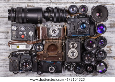 KIEV, UKRAINE - JULY 14. 2017 : illustrative editorial of various vintage photo cameras (35mm film) and old lenses made in USSR, close up