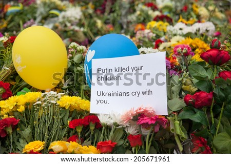 Kiev, Ukraine - July 18, 2014. People brought flowers and toys to the embassy of the Netherlands after the Malaysia Airlines B-777 (MH17) was shot down over Donetsk Region.