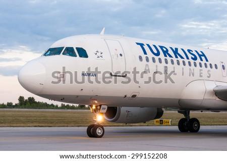 KIEV, UKRAINE - JULY 10, 2015: Turkish Airlines Airbus A320 at Borispol International Airport, Kiev, Ukraine. TurkisH Airline has over 18,000 employees and a fleet of 261