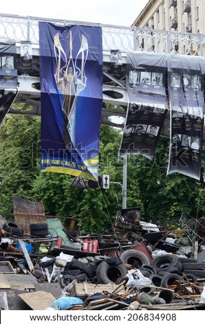 KIEV, UKRAINE - JUNE 19: Barricades with bridge and poster displaying symbol of \