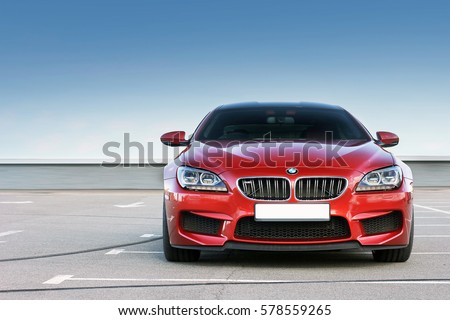 Kiev, Ukraine; June 25, 2013; BMW M6 against the clear sky. The car is on the right. Editorial photo.