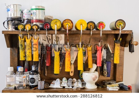 Kiev, Ukraine, - June 9, 2015: Paint rollers, marble mortar, oil paint and other accessories of painter in studio during a tour of the workshop