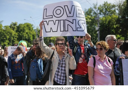 KIEV, UKRAINE - June 12, 2016: Ukrainian gay rights activists take part in a march in Kiev, Ukraine, Sunday, June 12, 2016. About one thousand gay rights activists marched in central Kiev on Sunday. #451095679