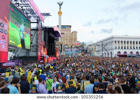 KIEV, UKRAINE - JUNE 15: Ukrainian, Swedish and English fans in fanzone before match Euro 2012 between Ukraine - France and England - Sweden on June 15, 2012 in Kiev, Ukraine. Zone for the fans EURO