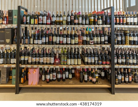 KIEV, UKRAINE - JUNE 04, 2016: Wine and champagne from different manufacturers closeup presented on the store shelves at Kyiv Wine Festival organized by Good Wine company in Parkovy Exhibition Center. #438174319