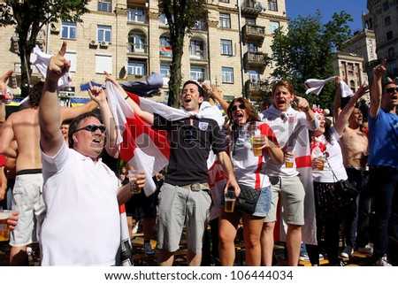 "KIEV, UKRAINE - JUNE 24: Women and men from England have fun in Fan-Zone of Euro 2012 on June 24, 2012 in Kiev, Ukraine. The slogan of EURO 2012 Football Championship is ""Creating History Together""."