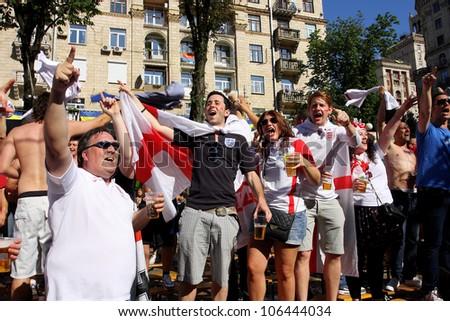 KIEV, UKRAINE - JUNE 24: Women and men from England have fun in Fan-Zone of Euro 2012 on June 24, 2012 in Kiev, Ukraine. The slogan of EURO 2012 Football Championship is \