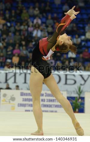 KIEV, UKRAINE - MARCH 31: Anna Dementieva, Russia performs floor exercise during International Tournament in Artistic Gymnastics Stella Zakharova Cup in Kiev, Ukraine on March 31, 2013