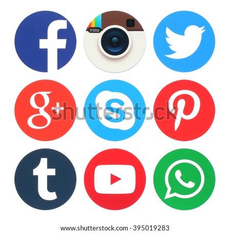 Kiev, Ukraine - March 23, 2016: Collection of popular round social media logos printed on paper:Facebook, Twitter, Google Plus, App Insta Instagram, Skype, Pinterest, Tumblr, Youtube and WhatsApp #395019283