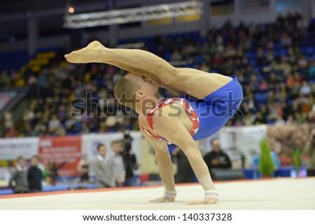 KIEV, UKRAINE - MARCH 31: Filip Ude, Croatia performs the floor exercise during International Tournament in Artistic Gymnastics Stella Zakharova Cup in Kiev, Ukraine on March 31, 2013