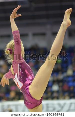 KIEV, UKRAINE - MARCH 31: Polina Fedorova, Russia performs floor exercise during International Tournament in Artistic Gymnastics Stella Zakharova Cup in Kiev, Ukraine on March 31, 2013