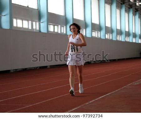 KIEV, UKRAINE - MARCH 04: Unidentified woman at the race walk on the Ukrainian Veterans Track and Field Championships on March 04, 2012 in Kiev, Ukraine.