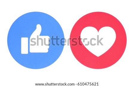 Kiev, Ukraine - May 27, 2017: Facebook like and love icons of Empathetic Emoji Reactions, printed on paper. Facebook is a well-known social networking service.