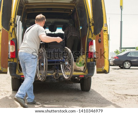 Kiev, Ukraine- May 18, 2019: loading wheelchairs into a minibus for transportation #1410346979