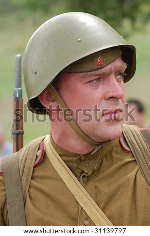 KIEV, UKRAINE - MAY 9: Member of history club called Red Star wears historical Soviet uniform as he participates in a WWII reenactment May 9, 2009 in Kiev, Ukraine.