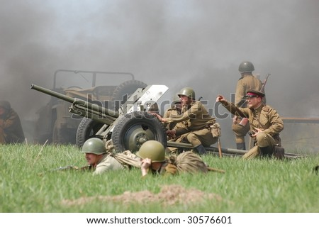 KIEV, UKRAINE - MAY 9: Members of history club called Red Star wear historical Soviet uniform as they participate in a WWII reenactment May 9, 2009 in Kiev, Ukraine.