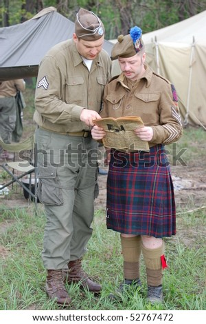 KIEV, UKRAINE - MAY 10 :  members of Red Star history club wears historical British&US uniforms during participation in 1945 WWII reenactment May 10, 2010 in Kiev, Ukraine.