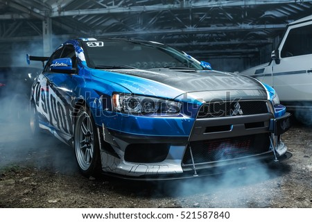 Kiev, Ukraine - 14 May 2014: Mitsubishi Lancer Evolution X tuning sport-car. It colored in blue, gray, whites colors with patterns and prints. Editorial photo.