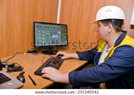 KIEV, UKRAINE - May 17 2013: The territory of the of the concrete plant. Work at the control panel #235340542