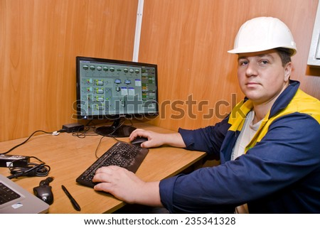 KIEV, UKRAINE - May 17 2013: The territory of the of the concrete plant. Work at the control panel #235341328