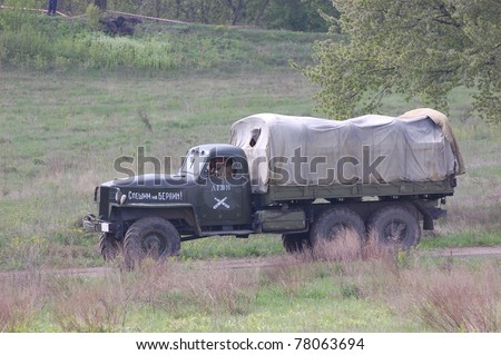 KIEV, UKRAINE - MAY 8 : Unidentified member of Red Star history club drives a WW2 Soviet truck during historical reenactment of WWII on May 8, 2011 in Kiev, Ukraine - stock photo