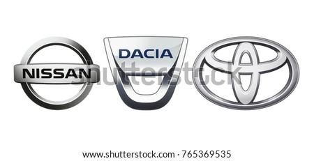 Kiev, Ukraine - November 09, 2017: Collection of popular car logos printed on white paper: Nissan, Dacia and Toyota