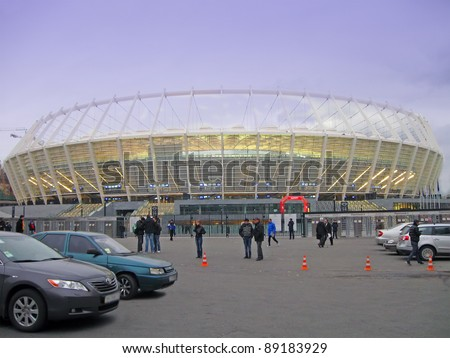 KIEV, UKRAINE -  NOVEMBER 11: Football attendees arrive at the Olympic National Sports Complex (AKA  Olympic Stadium, Central Stadium) for Euro 2012 football match between the Ukrainian and German teams on November 11, 2011 in Kiev, Ukraine.