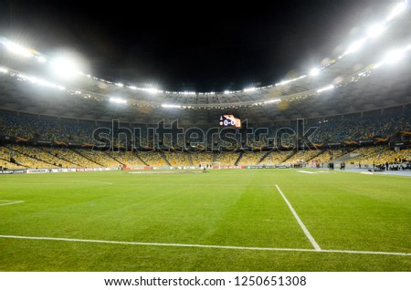 KIEV, UKRAINE - November 29, 2018: Night football stadium close up during the UEFA Europa League match between Vorskla Poltava vs FC Arsenal (England), Ukraine #1250651308