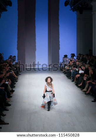 "KIEV, UKRAINE - OCT 10: Children model run on the runway during Fashion Show by ""ANISIMOV for 9,5"" ; by fashion designer Anisimov as part of Ukrainian Fashion Week, October 10, 2012 in Kiev, Ukraine."