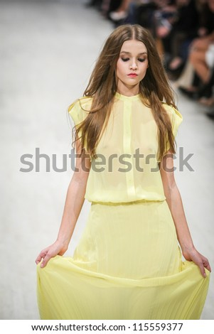 "KIEV, UKRAINE - OCT 10: Model poses at the runway during Fashion Show by ""Nadya Dzyak"" ; by fashion designer Nadya Dzyak as part of Ukrainian Fashion Week, October 10, 2012 in Kiev, Ukraine. - stock photo"