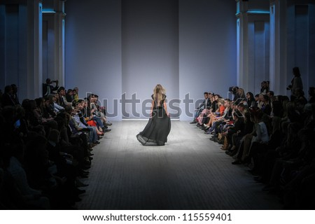 "KIEV, UKRAINE - OCT 10: Model poses at the runway during Fashion Show by ""Nadya Dzyak"" ; by fashion designer Nadya Dzyak as part of Ukrainian Fashion Week, October 10, 2012 in Kiev, Ukraine."