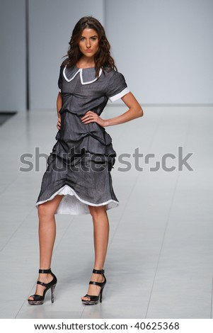 "KIEV, UKRAINE - OCT 18: Model poses at the runway during Fashion Show by ""SAVORONA"" as part of Ukrainian Fashion Week, October 18, 2009 in Kiev, Ukraine."