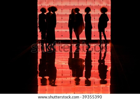 """KIEV, UKRAINE - OCT 15: Silhouette of models on the runway during Fashion Show by """"GROMOVA DESIGN"""" as part of Ukrainian Fashion Week, October 15, 2009 in Kiev, Ukraine."""