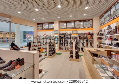KIEV, UKRAINE - OCTOBER 7: A lot of women and man shoes in Munchen shop, on a glass shelf in a long hall of a shoe store with inscriptions Sale, OCTOBER 7, 2014 in Kiev, Ukraine