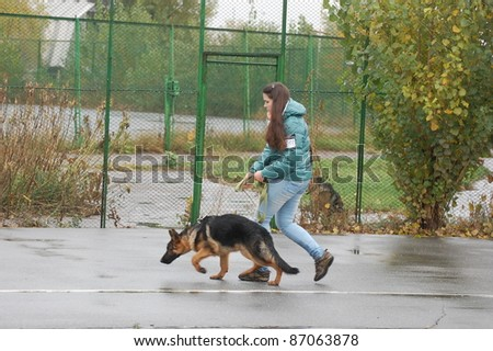 KIEV,UKRAINE-OCTOBER 15:An unidentified girl shows her dog at the Kiev Regional exhibition of dogs , on October 15, 2011 in Kiev,Ukraine