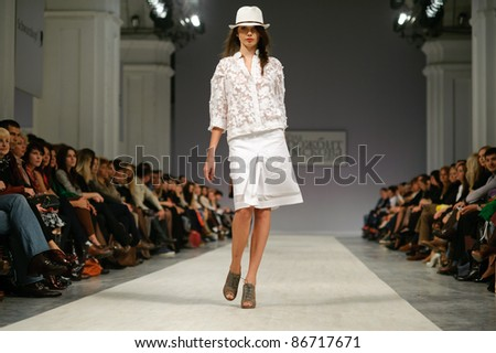 "KIEV, UKRAINE - OCTOBER 14: Fashion model wears clothes created by ""Tetyana ZEMSKOVA & Olena VOROJBIT"" at the Ukrainian Fashion Week on Oct. 14, 2011 in Kiev, Ukraine."